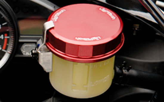 Replace the OEM or Brembo plastic Reservoir cover with a Lightech Round screw top in colour.